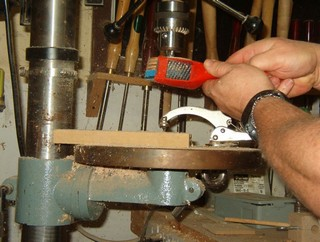 cleaning the assembly on the drill press