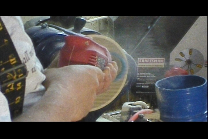wood turning power sanding image